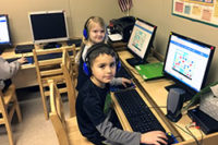 Pre-K through Kindergarten classes use computers and technology